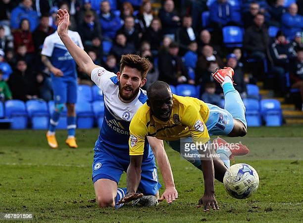 Shaun Brisley of Peterborough United tackles Sanmi Odelusi of Coventry City during the Sky Bet League One match between Peterborough United and...