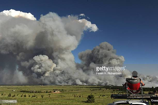 Shaun Buhrman of Aurora watches the fire from a high meadow north of the fire A wild land fire started around 200 in the Black Forest northeast of...