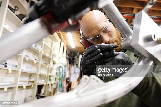 April 16: Shaun Burgers does a light drilling to ensure that the bolts will fit snug in the completed bike Friday, April 17, 2015 at Guerrilla...