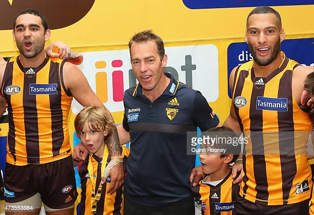 Shaun Burgoyne Alastair Clarkson and Josh Gibson of the Hawks sing the song in the rooms after winning the round seven AFL match between the Hawthorn...