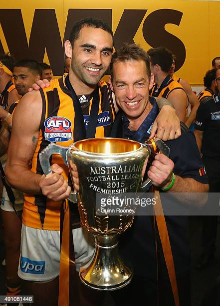 Shaun Burgoyne and Alastair Clarkson the coach of the Hawks celebrates with the trophy after winning the 2015 AFL Grand Final match between the...