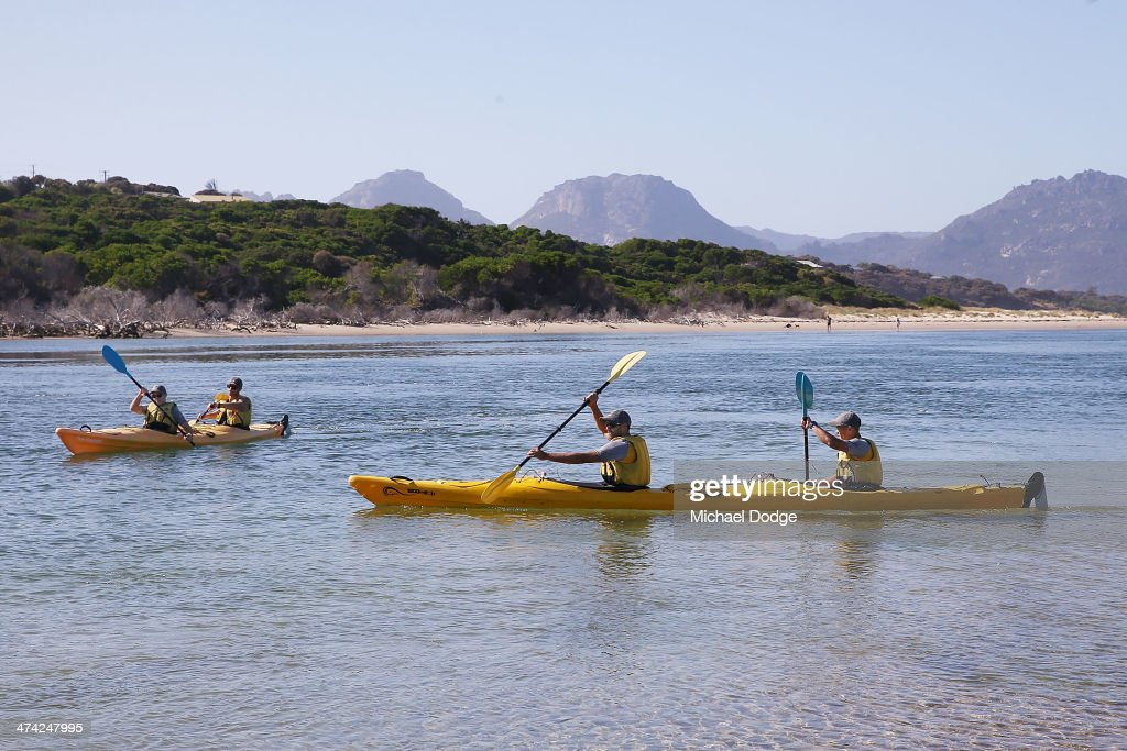 Shaun Burgoyne and Alex Woodward (R) and Ben Ross and Brad Sewell go kayaking at Dophin Sands in front of the Hazards mountain range during the Hawthorn Hawks Tasmania AFL Community Camp on February 22, 2014 in Swansea, Australia.