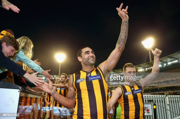 Shaun Burgoyne and Sam Mitchell of the Hawks wave to the crowd as they leave the field in their 250th games during the round six AFL match between...