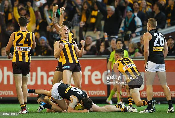 Shaun Burgoyne and Will Langford of the Hawks celebrate winning the AFL 2nd Preliminary Final match between the Hawthorn Hawks and the Port Adelaide...