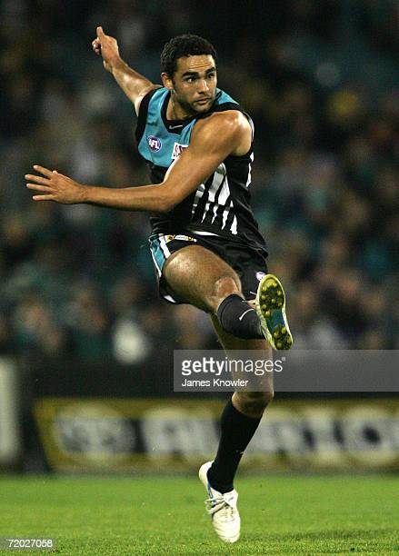 Shaun Burgoyne of Port offloads a kick during the round 12 AFL match between the Port Adelaide Power and the West Coast Eagles at AAMI Stadium on...