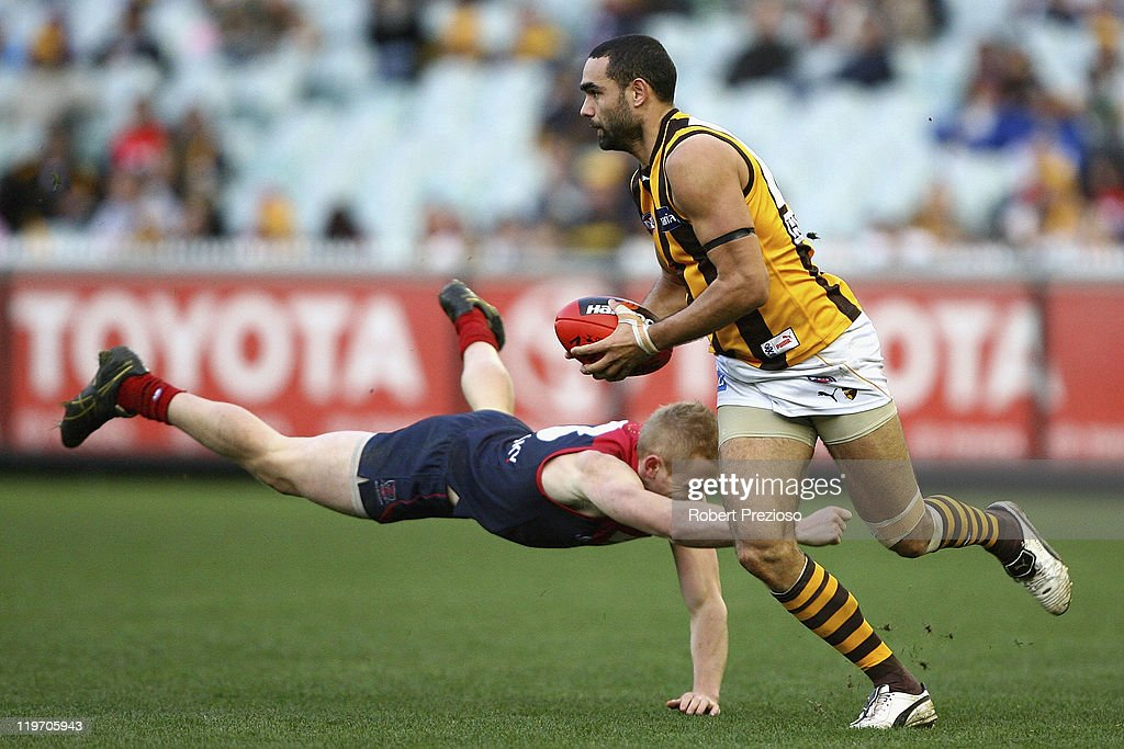 Shaun Burgoyne of the Hawks breaks a tackle during the round 18 AFL match between the Melbourne Demons and the Hawthorn Hawks at Melbourne Cricket Ground on July 24, 2011 in Melbourne, Australia.