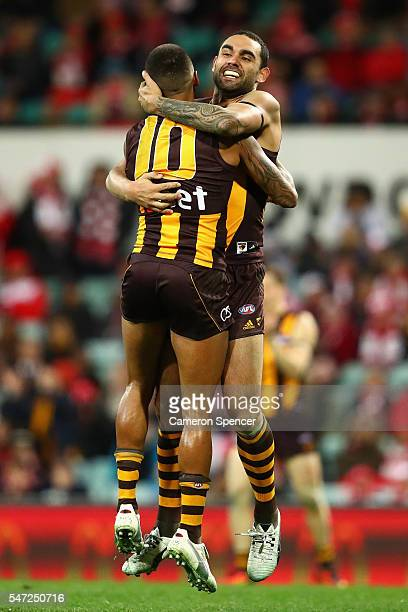 Shaun Burgoyne of the Hawks celebrates kicking a goal with team mate Bradley Hill during the round 17 AFL match between the Sydney Swans and the...