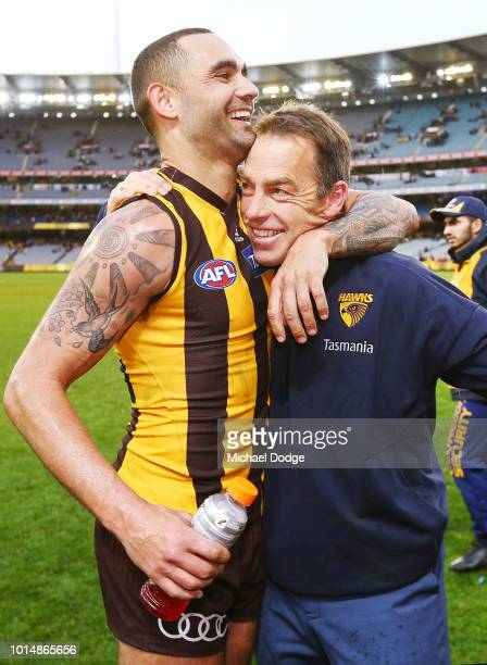 Shaun Burgoyne of the Hawks celebrates the win with Hawks head coach Alastair Clarkson in the round 21 AFL match between the Hawthorn Hawks and the...