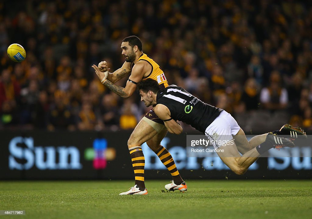 Shaun Burgoyne of the Hawks gets his handball away from John Butcher of Port Adelaide during the round 21 AFL match between the Hawthorn Hawks and Port Adelaide Power at Etihad Stadium on August 21, 2015 in Melbourne, Australia.