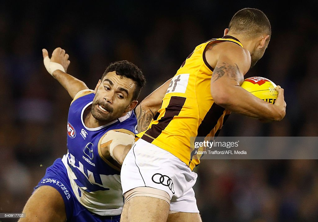 Shaun Burgoyne of the Hawks in action ahead of Lindsay Thomas of the Kangaroos during the 2016 AFL Round 13 match between the North Melbourne Kangaroos and the Hawthorn Hawks at Etihad Stadium on June 17, 2016 in Melbourne, Australia.