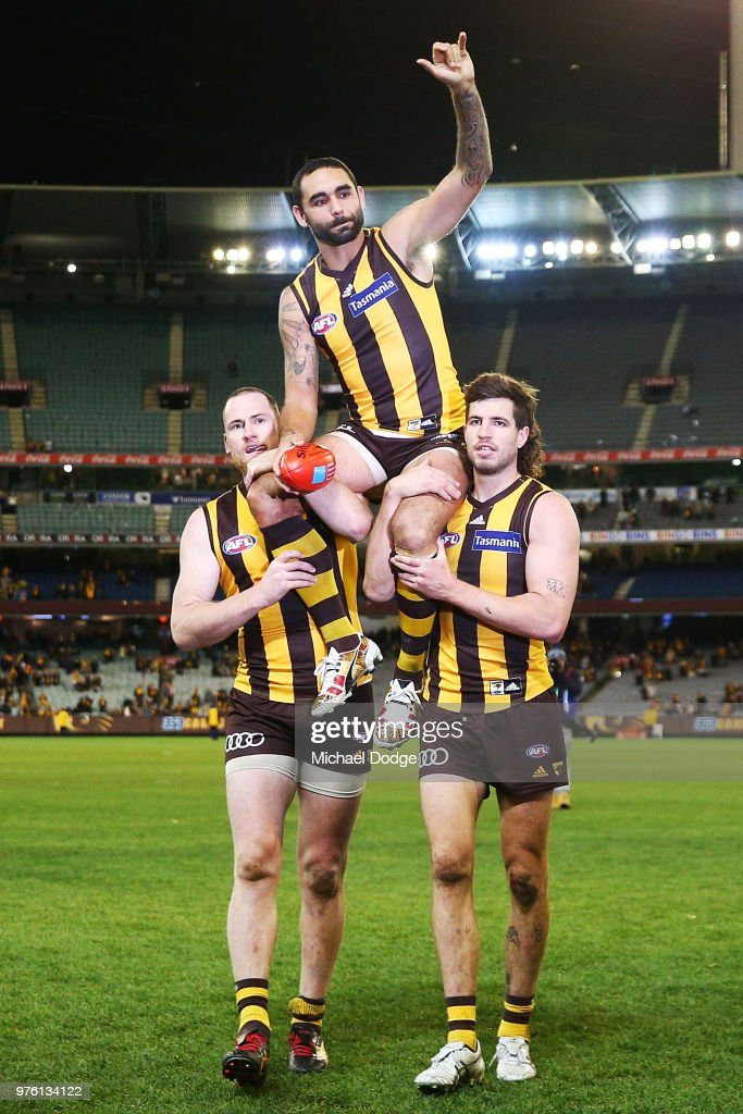 Shaun Burgoyne of the Hawks is carried off by Jarryd Roughead (L) and Ben Stratton (R) for his 350th match during the round 13 AFL match between the Hawthorn Hawks and the Adelaide Crows at Melbourne Cricket Ground on June 16, 2018 in Melbourne, Australia.
