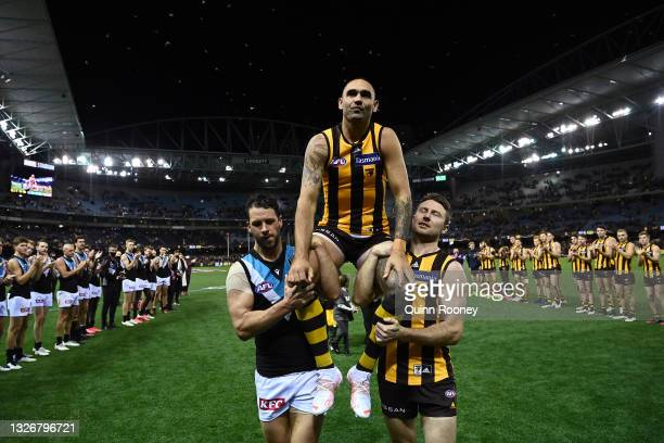 Shaun Burgoyne of the Hawks is chaired off in game 400 during the round 16 AFL match between Hawthorn Hawks and Port Adelaide Power at Marvel Stadium...