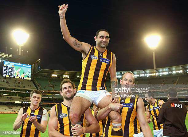 Shaun Burgoyne of the Hawks is chaired off the field in his 250th games during the round six AFL match between the Richmond Tiges and the Hawthorn...