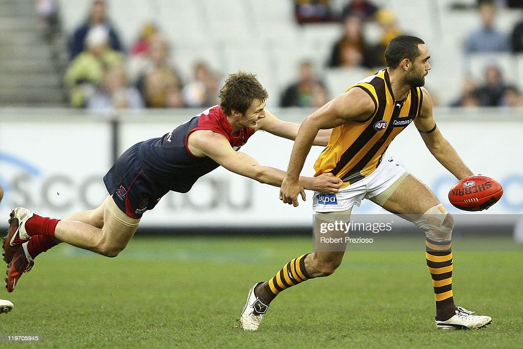 Shaun Burgoyne of the Hawks is tackled during the round 18 AFL match between the Melbourne Demons and the Hawthorn Hawks at Melbourne Cricket Ground on July 24, 2011 in Melbourne, Australia.