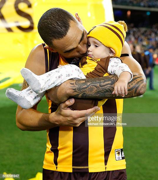Shaun Burgoyne of the Hawks playing his 300th match kisses daughter Nixie Blue during the 2016 AFL Round 05 match between the Hawthorn Hawks and the...