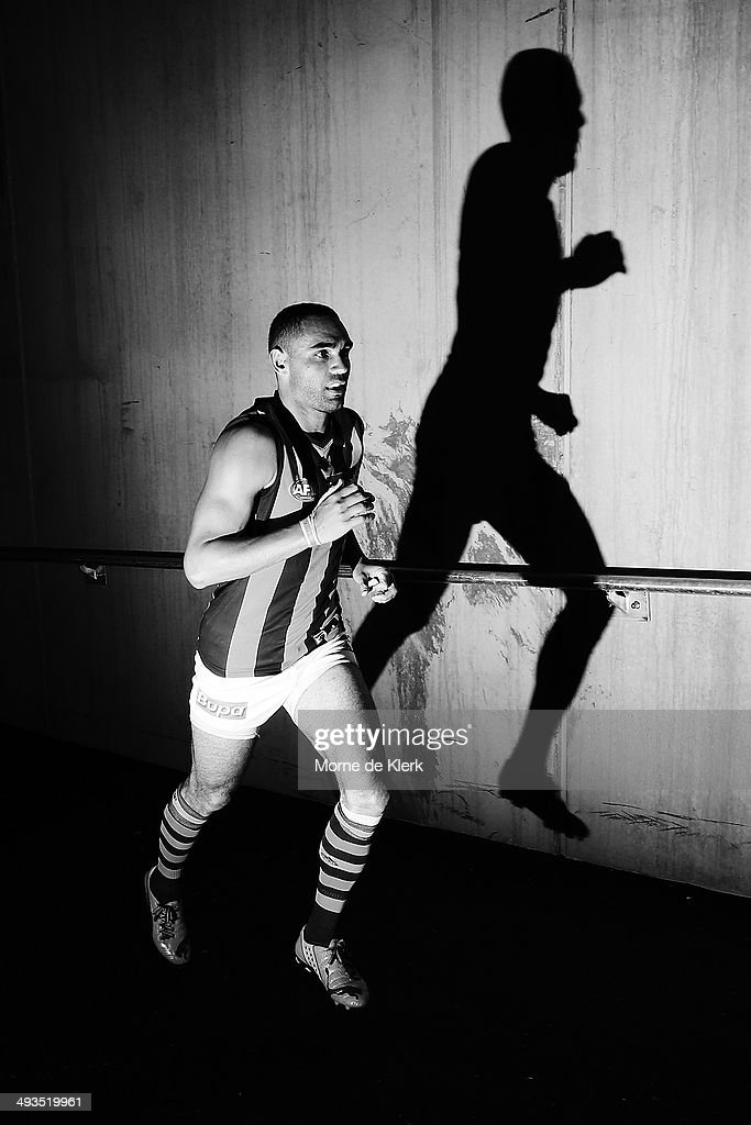 Shaun Burgoyne of the Hawks runs onto the field during the round 10 AFL match between the Port Adelaide Power and the Hawthorn Hawks at Adelaide Oval on May 24, 2014 in Adelaide, Australia.
