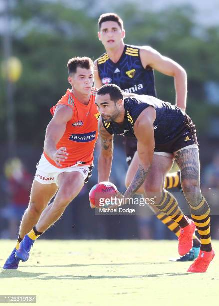 Shaun Burgoyne of the Hawks runs with the ball from Jaeger O'Meara of the Hawks during the Hawthorn Hawks AFL Intra Club Match at Waverley Park on...