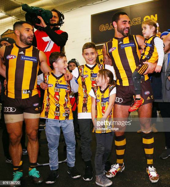 Shaun Burgoyne of the Hawks sing the club song after winning with his kids after his 350th match during the round 13 AFL match between the Hawthorn...