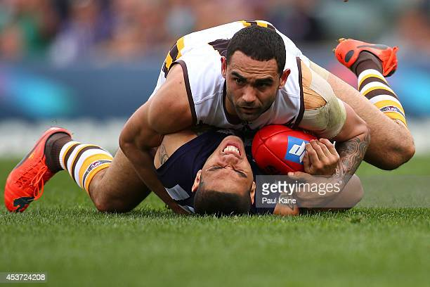 Shaun Burgoyne of the Hawks tackles Michael Walters of the Dockers during the round 21 AFL match between the Fremantle Dockers and the Hawthorn Hawks...
