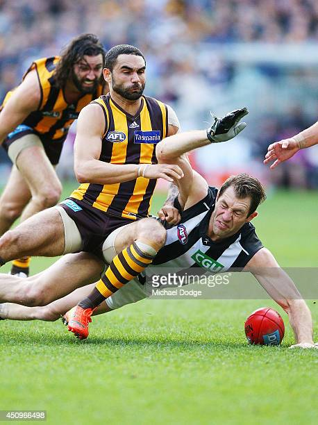 Shaun Burgoyne of the Hawks tackles Travis Cloke of the Magpies during the round 14 AFL match between the Hawthorn Hawks and the Collingwood Magpies...