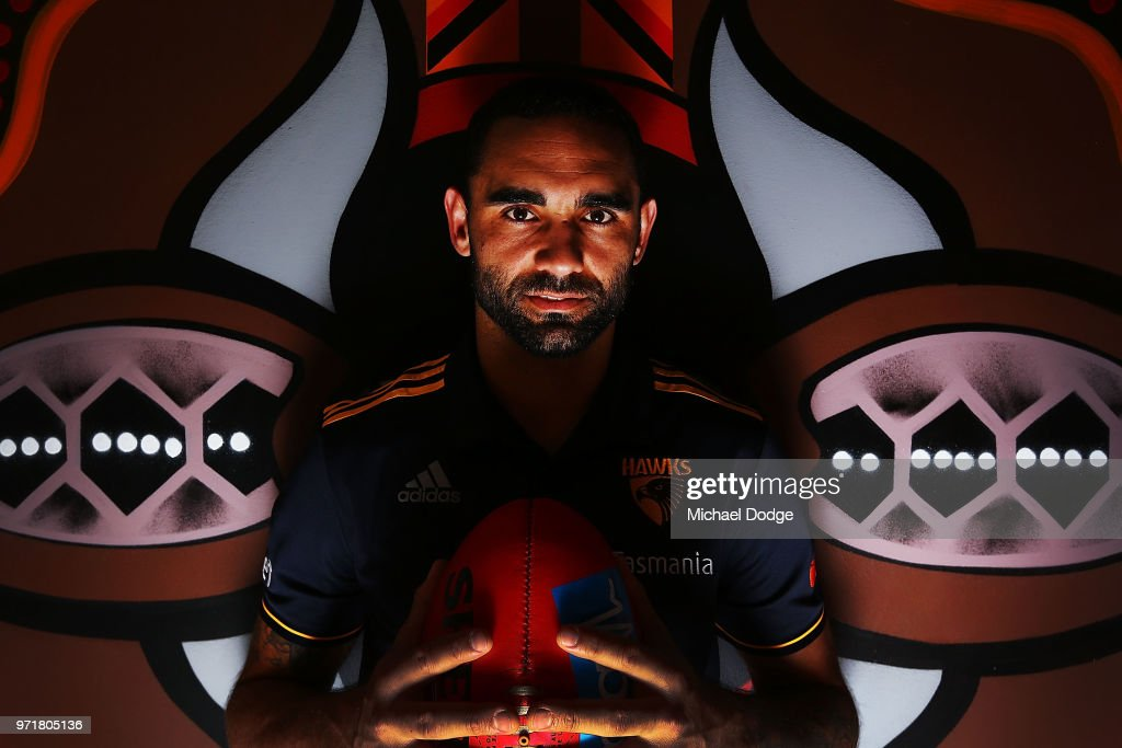 Shaun Burgoyne of the Hawthorn Hawks poses in front of an Indigenous artwork designed by teammate Cyril Rioli during a press conference at Waverley Park on June 12, 2018 in Melbourne, Australia.