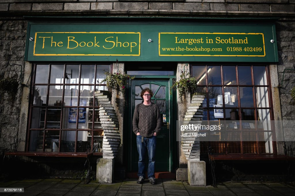 Shaun Bythell owner of The Book Shop, poses for a portrait outsidethe largest second hand store in the country on November 9, 2017 in Wigtown,Scotland. Wigtown has had official 'book town' status since 1998, with Mr Bythell owning Scotland's largest second hand book shop since 2001with a stock of over one hundred thousand books covering almost every imaginable subject.