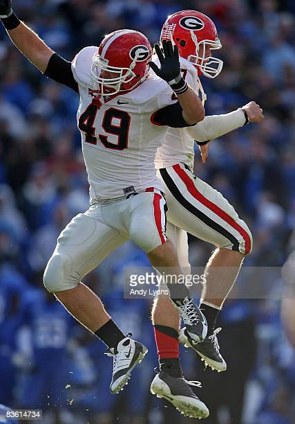 Shaun Chapas and Matthew Stafford of the Georgia Bulldogs celebrate after throwing the game winning touchdown against the Kentucky Wildcats at the...
