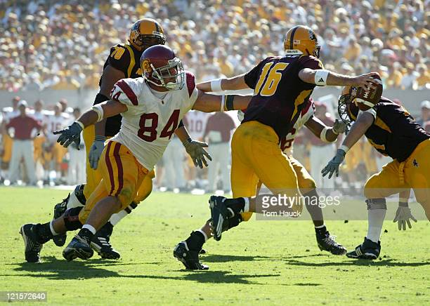 Shaun Cody of the USC Trojans chases Andrew Walter quarterback of the Arizona State Sun Devils at Sundevil Stadium in TempeAZ USC won 3717
