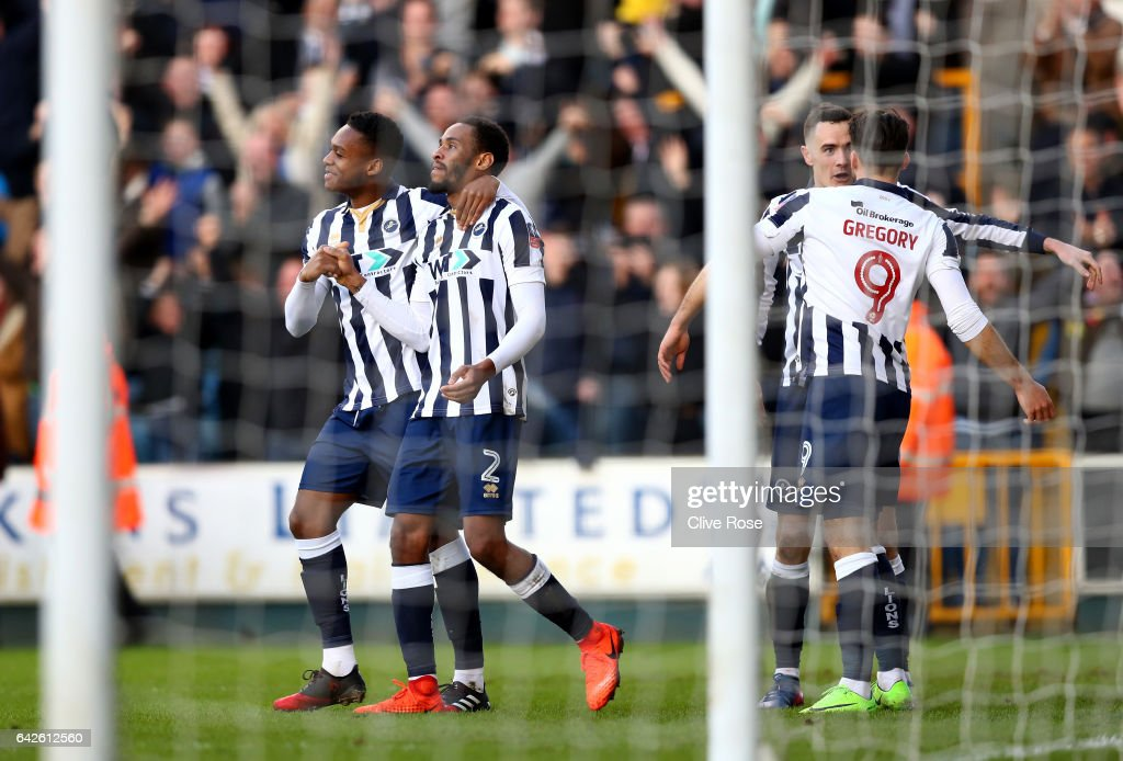 Shaun Cummings of Millwall (C) celebrates scoring his sides first goal during The Emirates FA Cup Fifth Round match between Millwall and Leicester City at The Den on February 18, 2017 in London, England.