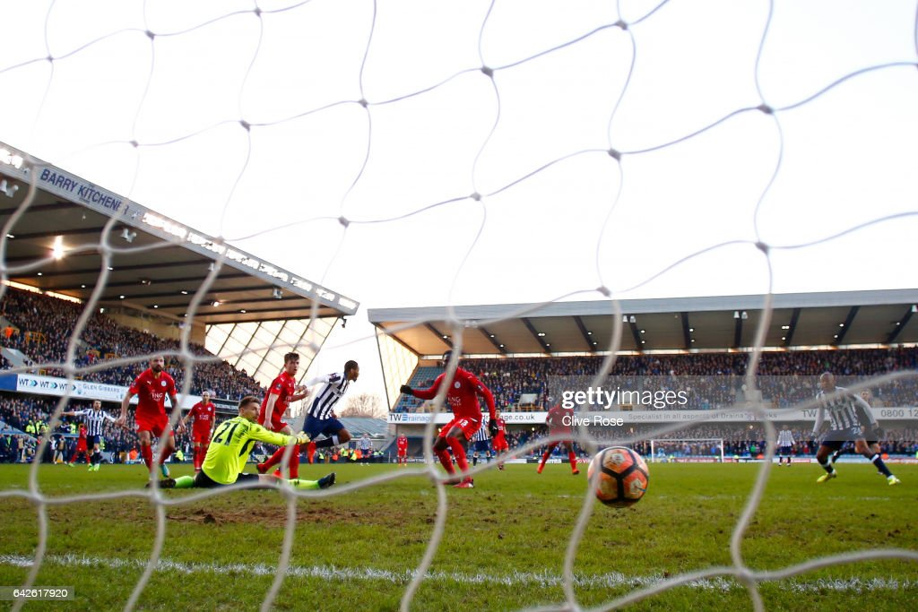 Shaun Cummings of Millwall scores his sides first goal past Ron-Robert Zieler of Leicester City during The Emirates FA Cup Fifth Round match between Millwall and Leicester City at The Den on February 18, 2017 in London, England.