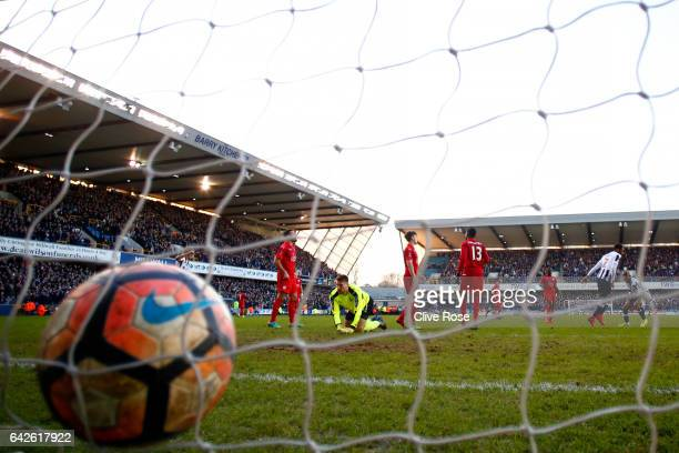Shaun Cummings of Millwall scores his sides first goal past RonRobert Zieler of Leicester City during The Emirates FA Cup Fifth Round match between...