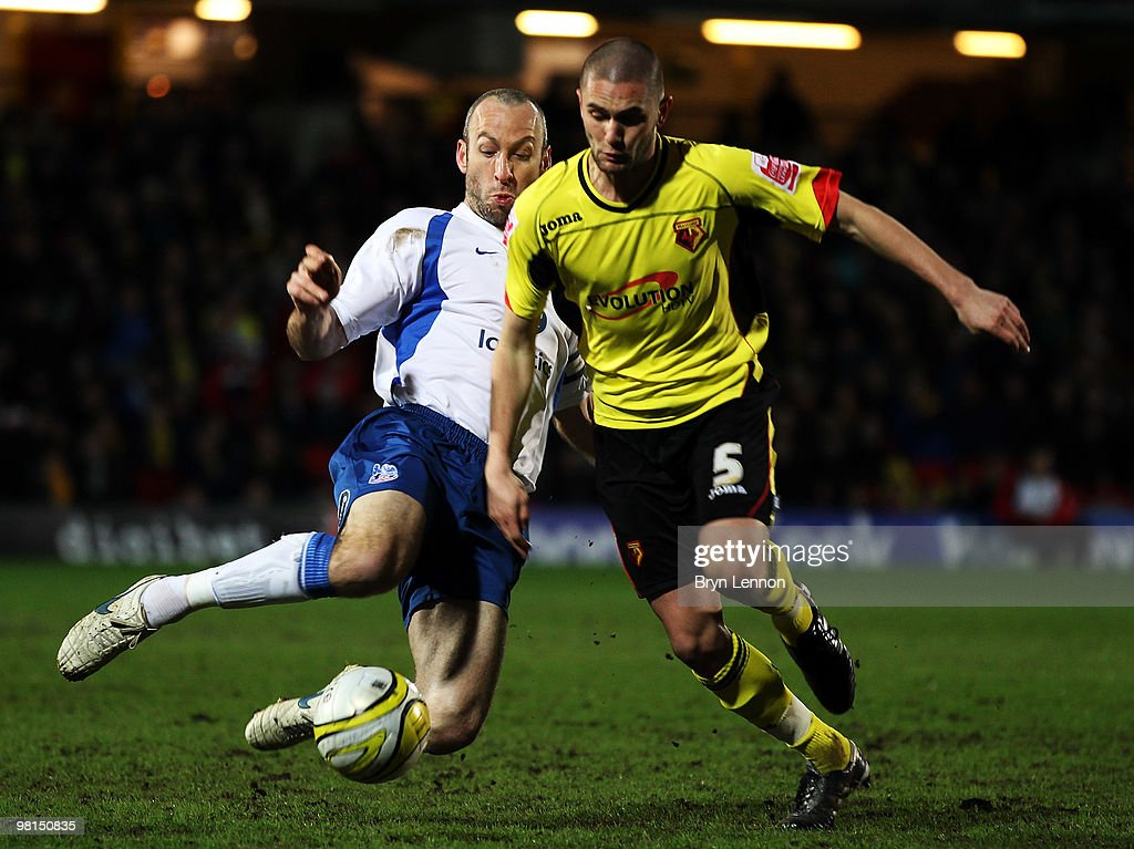 Shaun Derry of Crystal Palace tackles Henri Lansbury of Watford during the Coca-Cola Football League Championship match between Watford and Crystal Palace at Vicarage Road on March 30, 2010 in London, England.