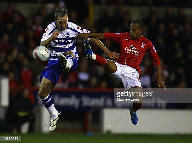Shaun Derry of QPR and Robert Earnshaw of Nottingham Forest challenge for the ball during the npower Championship match between Nottingham Forest and...