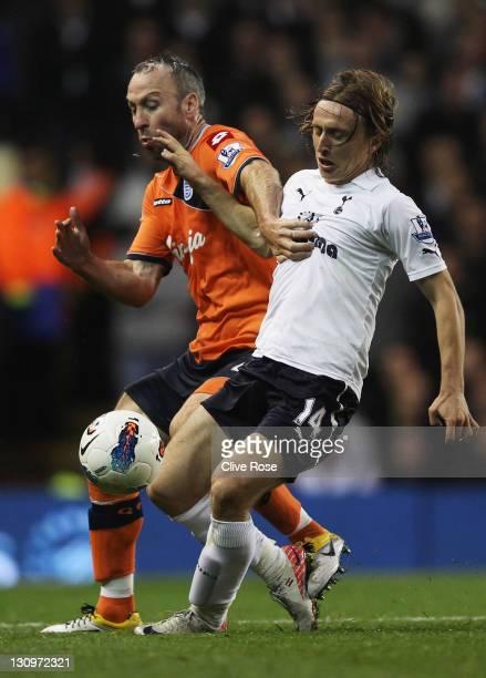 Shaun Derry of Queens Park Rangers battles with Luka Modric of Tottenham Hotspur during the Barclays Premier League match between Tottenham Hotspur...