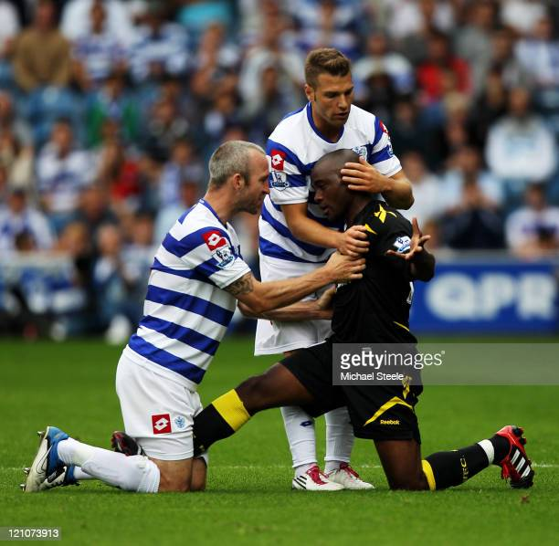 Shaun Derry of Queens Park Rangers clashes with Nigel Reo-Coker of Bolton during the Barclays Premier League match between Queens Park Rangers and...