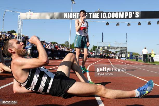 Shaun Dixon recovers after competing in the Highgate Harriers Night of the 10000m PBs at Parliament Hill Athletics Track on May 19 2018 in London...