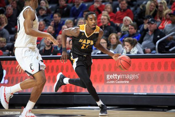Shaun Doss of the ArkansasPine Bluff Golden Lions brings the ball up the court in the game against the Cincinnati Bearcats in the second half at...