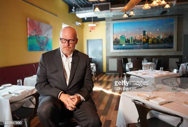 Shaun Dougherty speaks to AFP during an interview at his restaurant in the New York borough of Queens on August 23 2018 Dougherty says he is sick and...