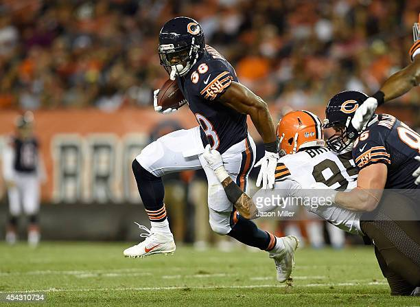 Shaun Draughn of the Chicago Bears breaks a tackle by Armonty Bryant of the Cleveland Browns during the first quarter at FirstEnergy Stadium on...