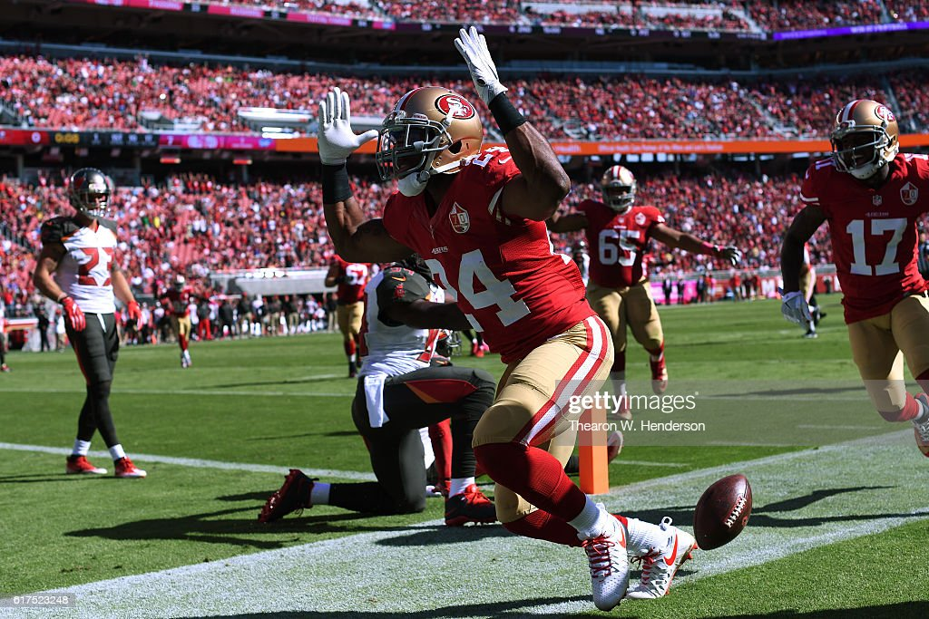 Shaun Draughn #24 of the San Francisco 49ers celebrates after scoring on a 17-yard pass against the Tampa Bay Buccaneers during their NFL game at Levi's Stadium on October 23, 2016 in Santa Clara, California.