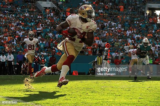 Shaun Draughn of the San Francisco 49ers rushes during a game against the Miami Dolphins on November 27 2016 in Miami Gardens Florida