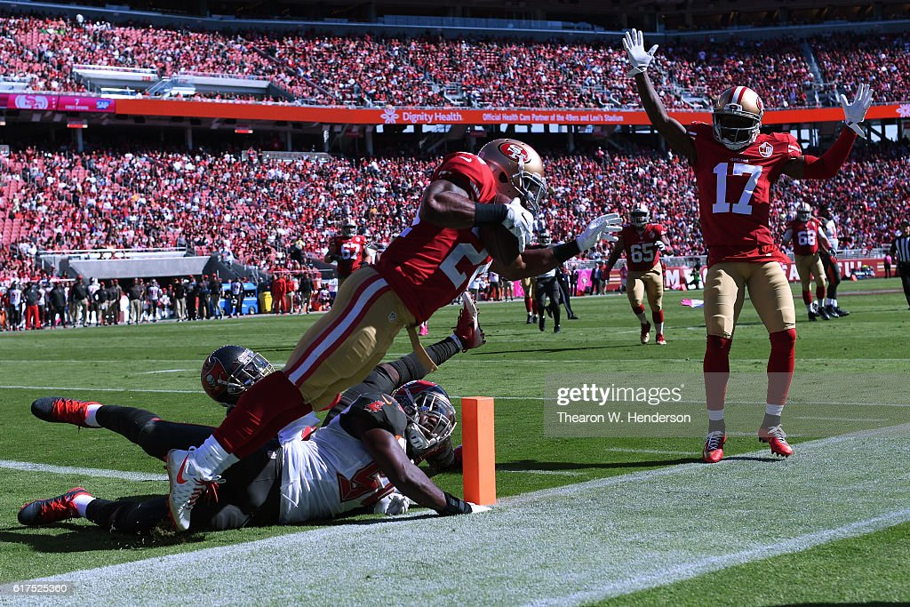 Shaun Draughn #24 of the San Francisco 49ers scores on a 17-yard touchdown catch against the Tampa Bay Buccaneers during their NFL game at Levi's Stadium on October 23, 2016 in Santa Clara, California.