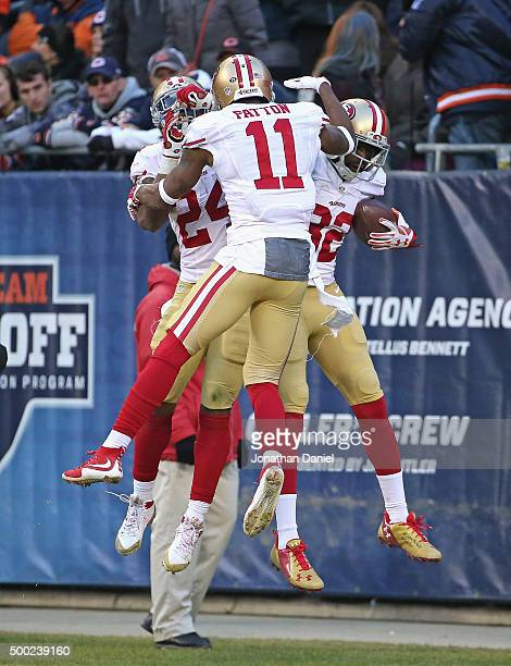 Shaun Draughn Quinton Patton and Torrey Smith of the San Francisco 49ers leap in celebration after Smith caught the gamewinning touchdown pass...
