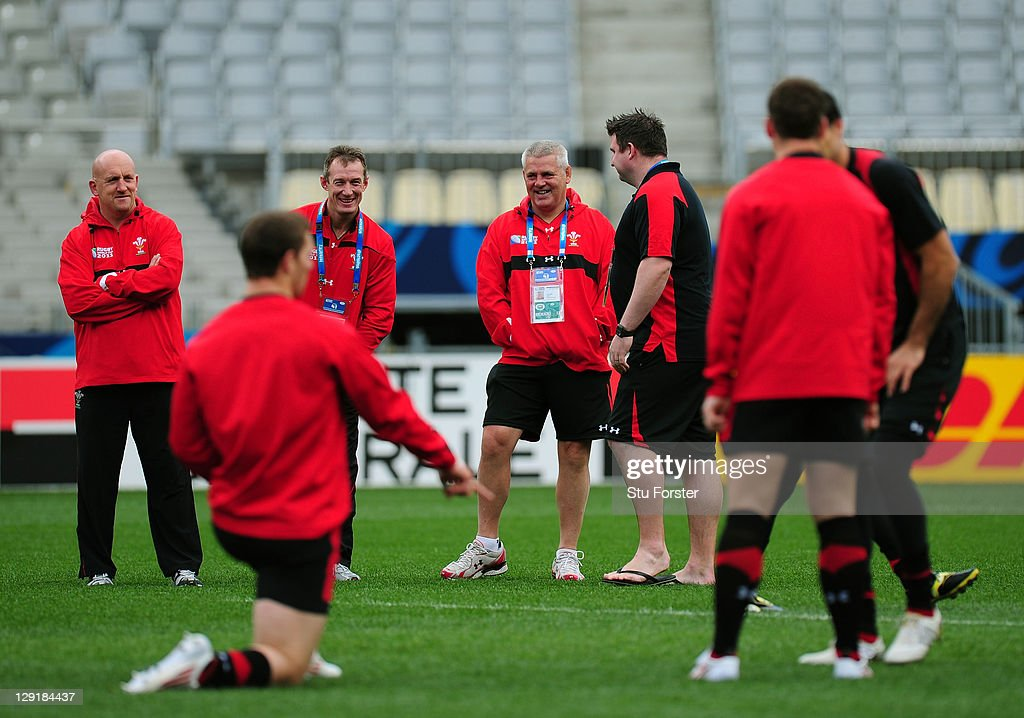 Shaun Edwards assistant coach (L), Rob Howley assistant coach (2nd L) and Rhys Long video analyst (R) speak with Warren Gatland head coach (2nd R) chat during a Wales IRB Rugby World Cup 2011 captain's run at Eden Park on October 14, 2011 in Auckland, New Zealand.