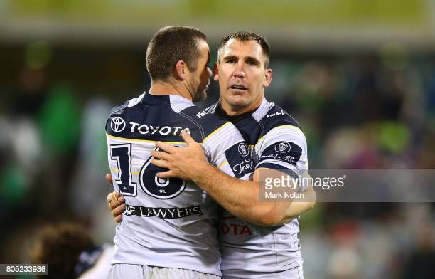 Shaun Fensom and Scott Bolton of the Cowboys embrace after winning the round 17 NRL match between the Canberra Raiders and the North Queensland...