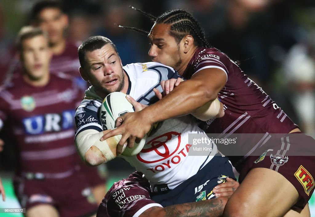 Shaun Fensom of the Cowboys is tackled by Martin Taupau of the Sea Eagles during the round 13 NRL match between the Manly Sea Eagles and the North Queensland Cowboys at Lottoland on May 31, 2018 in Sydney, Australia.
