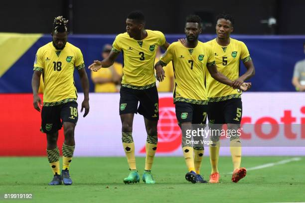 Shaun Francis of Jamaica celebrates with teammates after scoring the first goal of his team during the CONCACAF Gold Cup Quarterfinal match between...