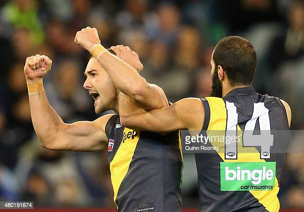 Shaun Grigg of the Tigers celebrates after kicking a goal during the round 15 AFL match between the Richmond Tigers and the Carlton Blues at...