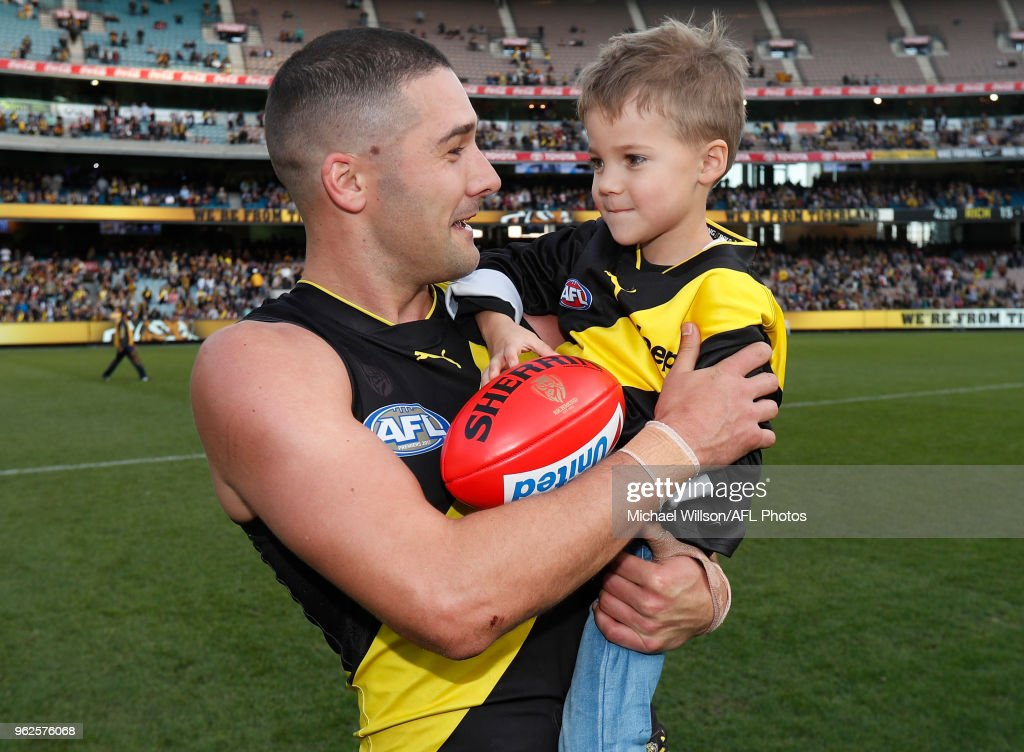 Shaun Grigg of the Tigers celebrates his 200th match with son Sonny after the 2018 AFL round 10 match between the Richmond Tigers and the St Kilda Saints at the Melbourne Cricket Ground on May 26, 2018 in Melbourne, Australia.