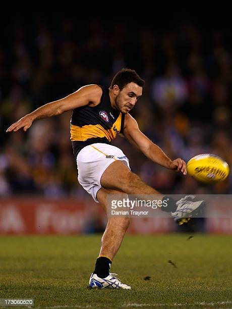 Shaun Grigg of the Tigers kicks the ball during the round 15 AFL match between the North Melbourne Kangaroos and the Richmond Tigers at Etihad...